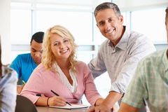Tutor helping student in class Royalty Free Stock Image