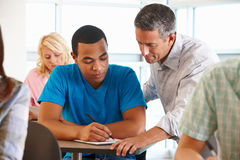 Free Tutor Helping Student In Class Royalty Free Stock Photo - 21042575