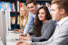 Tutor Helping Students Working At Computer Stock Photos