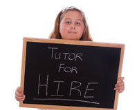 Tutor For Hire. A young girl holding a chalkboard showing that she wants to be hired to be a tutor, isolated against a white background Stock Photo