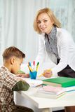 Tutor with pupil Royalty Free Stock Photography