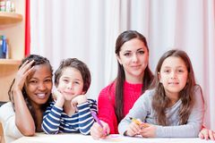 Tutor with smiling children stock photo