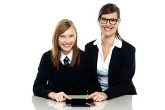 Tutor and student duo operating tablet pc Stock Image