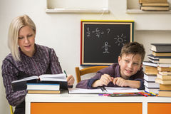 Tutor teaches a schoolboy before exams. Helping. Tutor teaches a schoolboy before exams royalty free stock photo