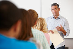 Tutor teaching class of students Stock Photo