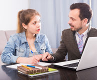 Tutor and teenage client. Young tutor helping teenage client to prepare for exams Stock Image