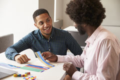 Tutor Using Learning Aids To Help Student With Dyslexia Stock Image