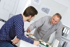 Tutor using learning aids to help student with dyslexia stock photography