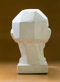Tutorial primitive plaster head model. Back view. Located against wall as a background Royalty Free Stock Images