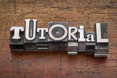 Tutorial word in metal type Royalty Free Stock Photos