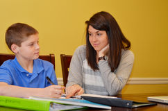 Tutoring. Tutor challenges her student in understanding a problem Stock Photography