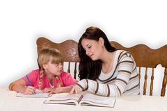 Tutoring. Big sister helping with homework Royalty Free Stock Photos