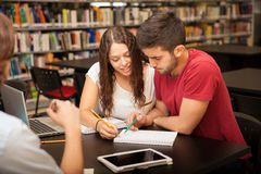Tutoring a friend at school Royalty Free Stock Images