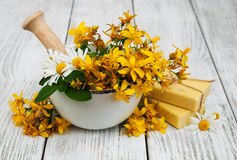 Tutsan flowers  and mortar with soap Royalty Free Stock Photography