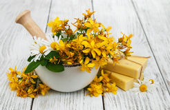 Tutsan flowers  and mortar with soap Royalty Free Stock Photos