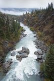 The Tutshi river at one of it`s most difficult rapids. In British Columbia`s Yukon suspension bridge Royalty Free Stock Photo