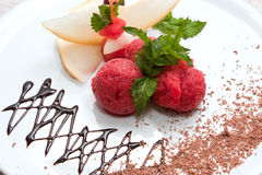 Tutti-frutti. Colored ice cream with fruit on a white plate with chocolate Stock Images