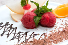Tutti-frutti. Colored ice cream with fruit on a white plate with chocolate Stock Photography