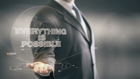 Tutto è nuove tecnologie disponibile di Holding dell'uomo d'affari possibile Immagine Stock