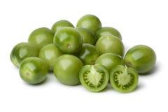 Tutto e pomodori a metà verdi Immagini Stock Libere da Diritti