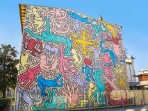 Tuttomondo, murals by the American artist Keith Haring in Pisa. Pisa, Italy - February 11, 2018: `Tuttomondo`, murals painted in 1989 by the artist Keith Haring royalty free stock photography