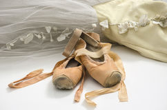 Tutu with ballet shoes. Ballet dress and an old pair of pointe shoes royalty free stock image