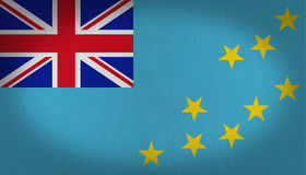 Tuvalu flag. With the british star at the top left side, with nine yellow stars in the right side over a blue back, fabric texture background Stock Images