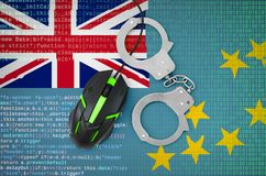 Tuvalu flag and handcuffed computer mouse. Combating computer crime, hackers and piracy. Tuvalu flag and handcuffed modern backlit computer mouse. Creative royalty free stock images