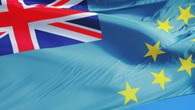Tuvalu flag in slow motion seamlessly looped with alpha. Tuvalu flag waving in slow motion against clean blue sky, seamlessly looped, close up, isolated on alpha stock video footage