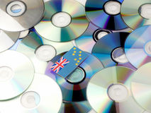 Tuvalu flag on top of CD and DVD pile isolated on white Royalty Free Stock Photo