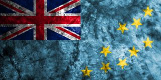 Tuvalu grunge flag on old dirty wall.  Royalty Free Stock Photography