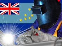 TUVALU WELDER. The current flag of Tuvalu was instated when the country became independent in 1978, after the separation from the Gilbert Islands in 1976 Royalty Free Stock Photography