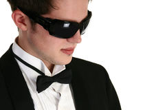 Tuxedo. Attractive teenager in tuxedo and sunglasses over white Royalty Free Stock Image