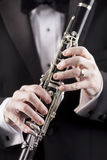 Tuxedo and clarinet Royalty Free Stock Image