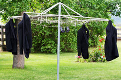 Tuxedo Coats On A Clothesline Stock Photo