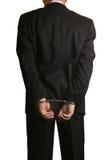 Tuxedo Cuffed. Handcuffed man in a Tuxedo from behind Stock Photos