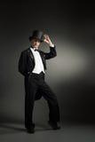 Tuxedo elegant man. On a black background stock photos