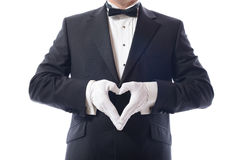 Tuxedo heart. Man in tuxedo with hamds in heart shaped pose Royalty Free Stock Photos