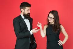 Tuxedo man and elegant lady at wedding party. formal couple. ring in box. love date and romance. bearded man make woman royalty free stock image