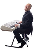 Tuxedo playing keyboard Stock Images
