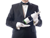 Tuxedo presenting champagne Royalty Free Stock Photo