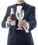 Tuxedo presenting glass of wine Stock Image
