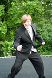 Tuxedo Teen Jumping On Trampoline Stock Images