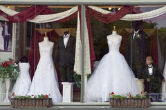 Tuxedo and Wedding Gown stock images