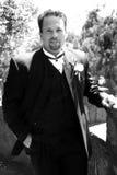 Tuxy class. Groom  poses for photo before wedding Stock Photos
