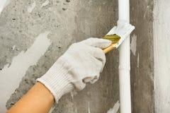 Tuyau de peinture de main du chauffage central de radiateur Photos libres de droits