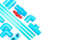 Tuyau de PVC et lame de scies bleus image libre de droits
