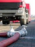Tuyaux d'incendie sur la prise de masse Images libres de droits
