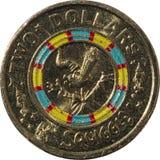 Två dollar australisk kopparmyntSquiggle arkivfoton