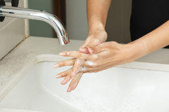 Tvättande händer med tvål Fotografering för Bildbyråer